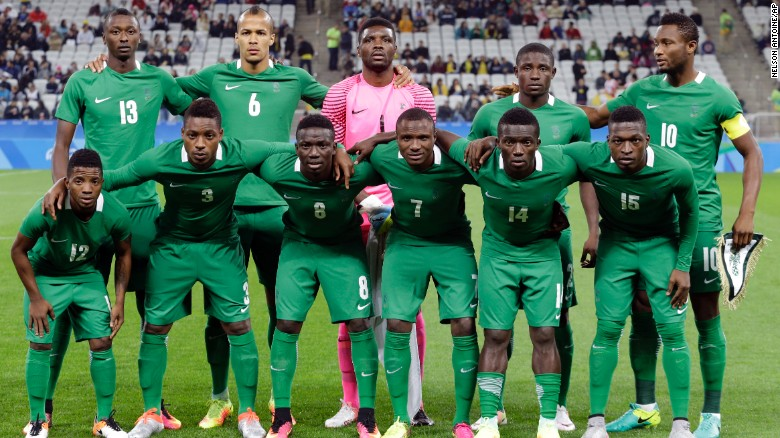 [The Nigerian team poses for photos before a match of the men's Olympic soccer tournament between Colombia and Nigeria in Sao Paulo, Brazil, on Wednesday, August 10, 2016. Credit: CNN]